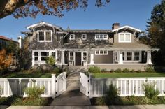 This home boasts many Craftsman characteristics, such as a knee wall railing, exposed rafters, square tapered columns and, of course, knee braces aplenty.