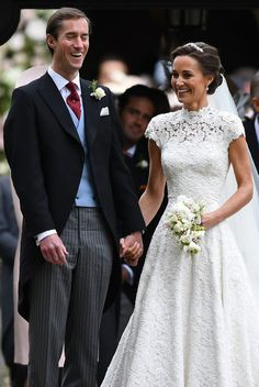 Pippa Middleton Photos Photos - Pippa Middleton (R) reacts following her wedding to James Matthews at St Mark's Church in Englefield, west of London, on May 20, 2017..After turning heads at her sister Kate's wedding to Prince William, Pippa Middleton graduated from bridesmaid to bride on Saturday at a star-studded wedding in an English country church. Middleton married financier James Matthews, 41, at a ceremony attended by the royal couple and tennis star Roger Federer, as she wore a…