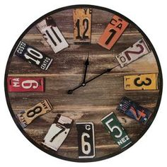 """Add rustic-chic appeal to your living room or den with this delightful wood wall clock, showcasing a round silhouette and license plate-inspired dial. Product: Wall clockConstruction Material: Wood and metalColor: Rustic wood and multi Accommodates: Batteries - not included Dimensions: 23.75"""" Diameter Cleaning and Care: Wipe clean with a damp cloth"""