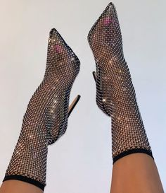 Sparkly, glitzy and sexy jeweled shoes, featuring a fishnet boot in black and multi color diamante detail.