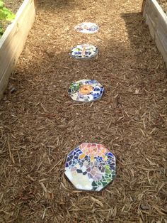 Diy mosaic or gem stepping stones - This also explains how to make stepping stones with your child's handprint, footprint and name