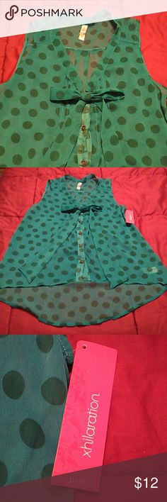 NWT  S/P  Xhilaration Blouse Lovely Aqua green poka dot blouse. Ties with a bow in the front. Longer in the back the the front. Semi sheer 100% polyester. Machine washable. Xhilaration Tops Blouses