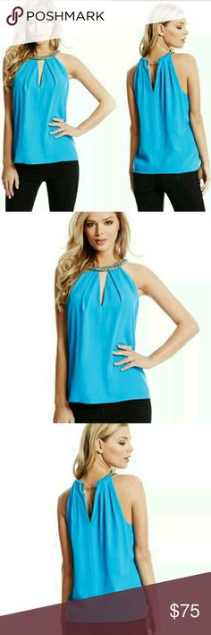 Guess by Marciano Blue Gisela Chain Top Size S Cocktail hour calls for casually glamorous style, making this top your new evening go-to. The chain neckline adds luxurious edge to the sultry silhouette.  Woven top. Halter neckline. Sleeveless. Multi-row chain neckline with braided detail. V-shaped cutout at bust and upper back. Lobster clasp closure at back neck. Lined. Shell: 96% Polyester, 4% Spandex. Lining: 100% Polyester. Hand wash *Labels have been slit to prevent store returns* Guess…