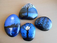 Pebbles painted with scenery!