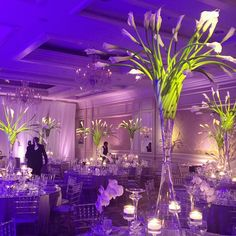 Finishing details for a wedding reception at Four Seasons Hotel Chicago. Candid photo by Colby Price