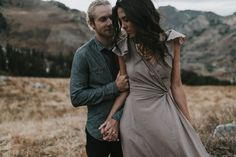 Loving the dark neutral palette this couple chose for their engagement outfits to match the natural landscape   Image by Blush Photography