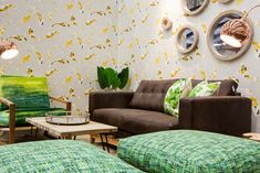 Green furniture. Patterned wallpapers.