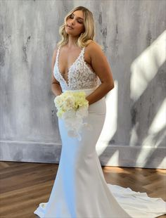 Tommy Crepe is elegant and charming with a subtle, daring edge that will captivate your senses. This bridal gown features a plunging neckline with plunging V back with delicate straps. Tommy has a gorgeous fitted silhouette, complemented by a long, statement train and stretch crepe skirt.