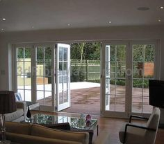 Bifold doors which can act like patio doors in case you only want to go into the garden or let in some air. but not these faux-Georgian