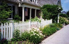A beautiful home #garden with a white picket fence in #CentralOhio