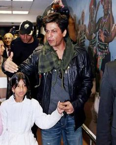 Shah Rukh Khan holding hands with his daughter Suhana