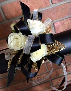 Black and Gold Corsage. Custom Creation by Jackson Florist. #prom #homecoming #wristcorsage #danceflowers #boutonniere #corsage
