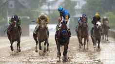 The 140th running of the Preakness was a bit damp at Pimlico Saturday.