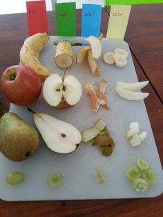 Fruit herkennen en bespreken, heel, half, schil en eten.