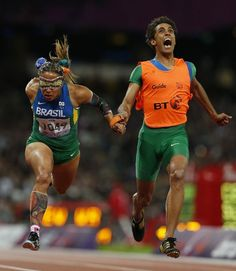 Reuters, 100 best photos of 2012 -  Paraolympics, blind sprinter  Terezinha Guilhermina from Brazyliiand her guide Guilherme Soares de Santana win 100 m sprint