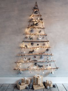 Alternative Christmas tree: this rustic hanging tree has been carefully created using ten natural birch branches hung together with strong jute string. Each branch has a dusting of sparkly snow.