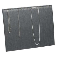 "This gray linen necklace display is supported by an easel and holds necklaces up to 24"" long on 15 individual brass hooks. Easels offer the advantage of showing jewelry at an attractive, easy-to-see angle with the added benefit of folding flat for secure, space-saving storage and travel. Suspend a necklace on each hook, or drape a single necklace over three or more hooks to show off a particular chain pattern. Dyed dark-gray linen covers a sturdy, medium-density fiberboard (MDF) material. Jewelry Displays, Necklace Display, Fabric Display, Rio Grande Jewelry, Brass Hook, Easels, Bold Jewelry, Jewelry Making Supplies, Jewelry Findings"