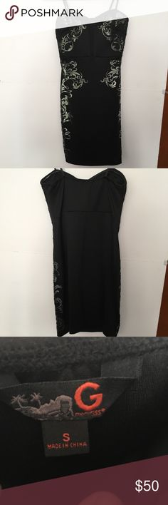 Guess Black dress Super cute black Guess dress, size S. With shiny silver design! Worn once! In new condition! Guess Dresses Strapless