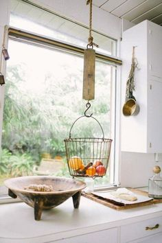 Love this idea for hanging a fruit basket.