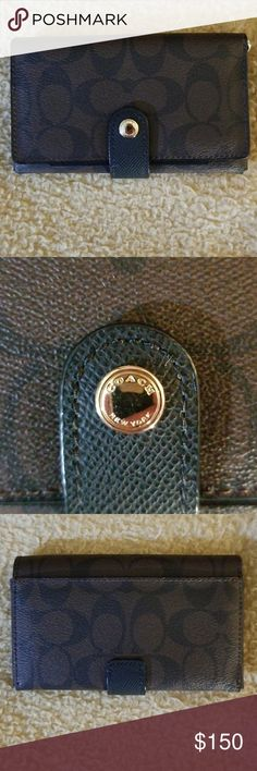 Authentic COACH Wallet COACH leather wallet is made of coated canvas and leather. There is one outside open pocket. Inside there are 6 card pockets. Was used only minimally. Coach Bags Wallets
