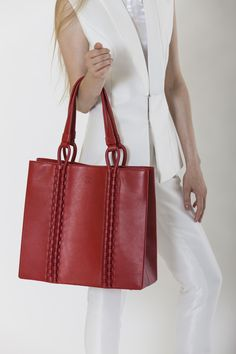 I love this RED tote with intricate  hand-woven leather rope technique by TATYZ