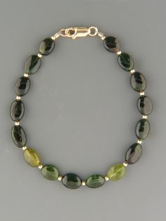 Green Tourmaline Bracelet - oval stones with Gold beads