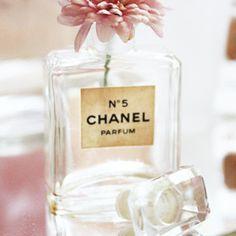 Using old perfume bottles as vase? Nice...