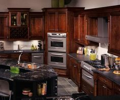 I really like this kitchen with dark stained cabinets black granite countertops and a wine rack above in the cabinets