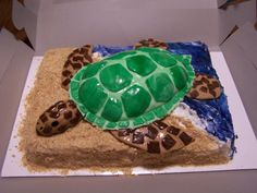 Sea Turtle Cake - This cake was made for someone who HATES turtles as payback on her birthday. :-) It is a white cake with Wilton's Decorator Icing.  The turtle is made from RKT & Fondant.  I used the Wilton Egg-shaped pan to form RKT the shell.  Sand is crushed vanilla wafers & water is tinted piping gel.   The best part of all is when someone removed the head and started chasing her around the restaurant. :-o