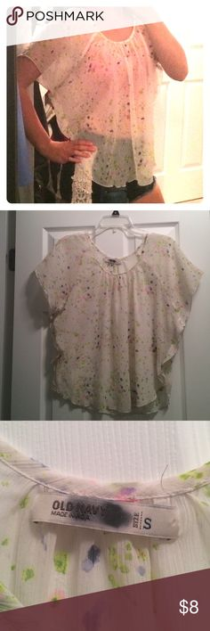 Flowy Old Navy top Boho top with what looks like splatter paint flowers. Very sheer and billowy material. Pairs great with a fun bralett and jean shorts. The tag is NOT stained, when I bought it the clerk marked it because I was not allowed to return it since it was originally an online purchase made by someone else. In great condition! Old Navy Tops Blouses