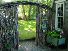 sticks and logs are free and make a great fence! Love the arched entryway. In wine country there are vines that get trimmed all the time! Monaraebeads.etsy.com