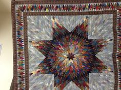 Shimmering Lone Star by Blanche Young, displayed by Helen Young Frost at Village Quilters Guild.