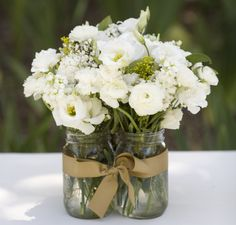 Mason Jars are a must!! White flowers and ribbon