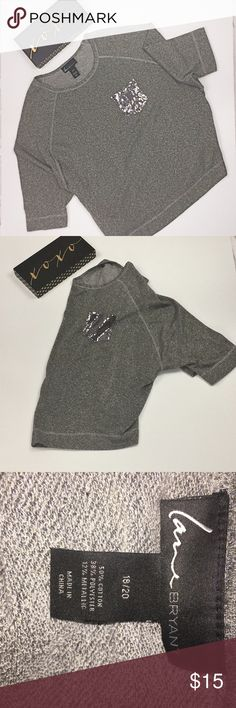 Shine bright and look casual chic Sparkly metallic material and sequined pocket makes this top shine!!  The casual sweatshirt cut and shorten sleeves give a casual edge to this piece. Top is comfy to wear.  Lane Bryant Lane Bryant Tops
