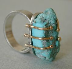 Turquoise sterling  14kt gold ring by betsy.bensen. The balls at the endings of the prongs at the base.