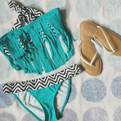 NWOT Pacsun swimsuit  bikini with fringe Never worn swim suit bikini. Lira brand from Pacsun. Cute black and white tribal pattern with turquoise boho fringe on top and detailing on bottoms. Top has removable pads. Great quality. Size medium in both top and bottoms. NWOT PacSun Swim Bikinis
