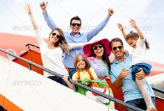 Family traveling by airplane. http://photodune.net/item/family-traveling-by-airplane/2774732?WT.oss_phrase=family%20traveling&WT.oss_rank=2&WT.z_author=andresrphotos&WT.ac=search_thumb