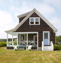 What a lovely porch on this shingle-style home! Learn more about shingle style… Cottage Plan, Cottage Living, Coastal Cottage, Cottage Style, Beach Cottage Exterior, Nantucket Cottage, Shingle Style Architecture, Shingle Style Homes, Cottages By The Sea