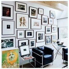 Usually I like a mix of prints paintings etc. but this eclectic photo wall REALLY gets it right. Not enough room on the wall? Simply put it on the floor and prop it up! The Le Corbusier chairs definitely help too!!