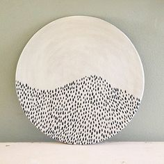 Ceramic plate, nearly black deep blue and white organic design. Tiny lines.