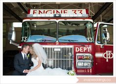 The groom, a fireman at his station with his bride - fireman wedding, firefighter wedding