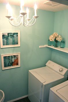 I think I'm gonna do this to my laundry room. I love this color, and happen to have a full can of it that I've never used. With white tile and white cabinets with vintage black glass handles, super cute! I might even do the chandelier!