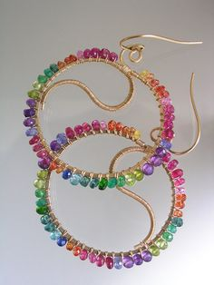 ...........curvy and teeming with color drenched gems.    18 gauge 14k gold filled wire lengths have been forged into hoop style earrings with