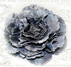 More than several tutorials on how to make different kinds of flowers using Spellbinders dies - Peony Creations, Rose Creations, Carnation Creations, etc.