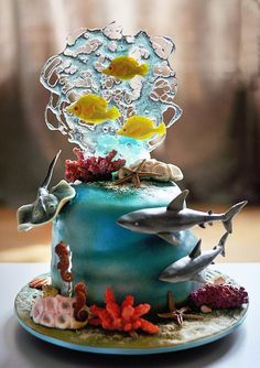 This cake looks as though it is under water. Fluid movement is remarkable. Seaworld Cake ... http://cakesdecor.com/cakes/204186-seaworld-cake… #cake #cakedecorating