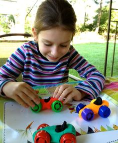 Play-Doh Cars ~ use colorful, twist-off caps from baby food pouches for the wheels