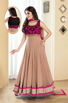 Anarkali suit in net material - Most catchy part in this suit is designer yoke portion. Ghera of this long anarkali suit is edge with stylish lace borders.