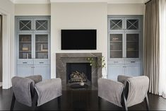 A master suite sitting room is made more luxurious with a cozy hearth.
