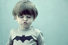 So Cute!! This little boy looks like my brother when  he was a kid! With his Batman shirt on & everything. haha =D