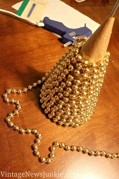 Upcycled Sparkly Christmas Tree {Gold Beads & a Cemetery Vase} | Vintage News Junkie